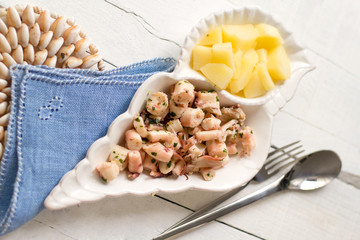 typical italian recipe with steamed octopus and potatoes