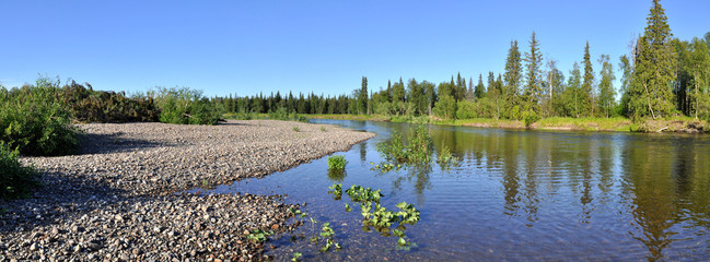 Panorama pebbly shore taiga river.