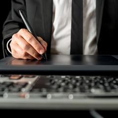 Businessman using a tablet and stylus