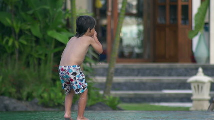 Boy nosediving in the swimming pool, slow motion shot at 240fps