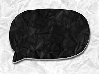 black speech bubble on crumpled paper