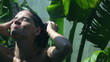 Woman showering face in the garden, slow motion 240fps