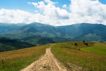 Dirt road against the landscape in the Ukrainian Carpathians