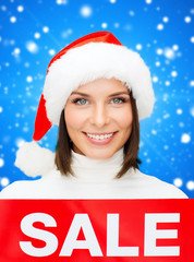 smiling woman in santa helper hat with sale sign