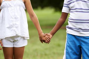 Children love black boy white girl holding hands