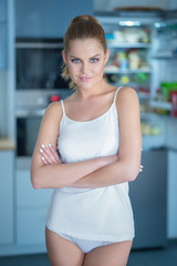 Shapely attractive young woman in sleepwear