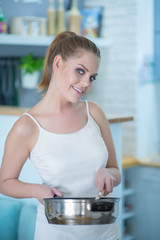 Young Woman in Underwear Holding Frying Pan