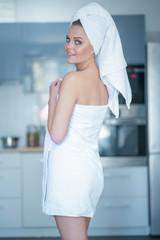 Woman Wearing Bath Towel Looking Over Shoulder