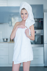 Smiling Young Woman Wearing Bath Towel