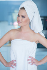Young Woman Wearing Bath Towel with Hands on Hips