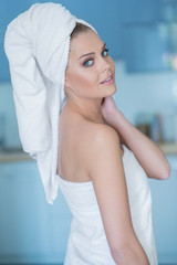 Young Woman in Bath Towel Looking Over Shoulder