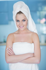 Smiling Woman in Bath Towel with Arms Crossed
