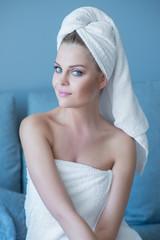 Young Woman Wearing Bath Towel Sitting on Sofa
