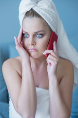 Stressed Woman in Bath Towel with Cell Phone