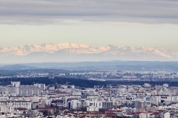 View of the city of Lyon with Alps mountains