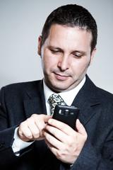 Businessman using cellphone