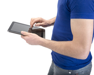 Manual worker pointing on tablet PC with his dirty hand
