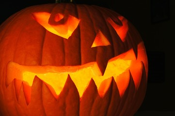 Spooky Halloween Jack o Lantern close up at night