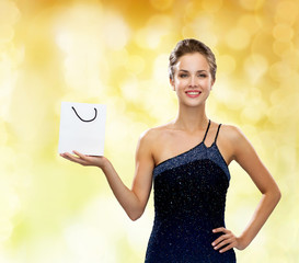 smiling woman with white blank shopping bag