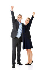 Victorious business couple with hands up