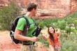 Helping hand - hiking woman getting help on hike
