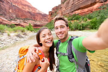Travel hiking selfie by happy couple on hike