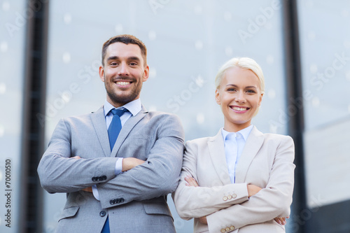 canvas print picture smiling businessman and businesswoman outdoors