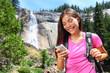 Smartphone - woman hiker using smart phone on hike