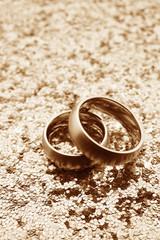 Wedding bands on glitter