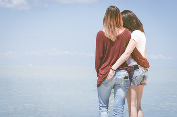 girls hugging at the pier