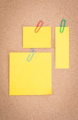 Yellow note on corkboard background