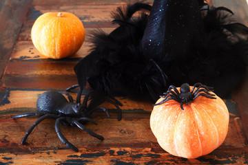 Halloween pumpkins, spider, hat of witch