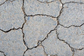 old asphalt cracks texture background