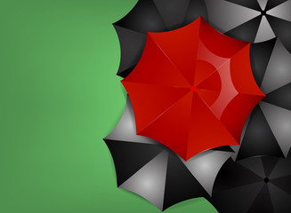 Red umbrella on a green background