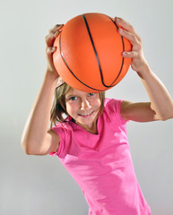 young basketball player makes a throw