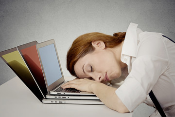 Sleeping woman at her desk, on computer dreaming