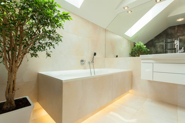 Illuminated bathtube in modern bathroom