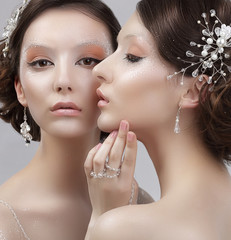 Close Up Portrait of Two Fashionable Women with Trendy Makeup