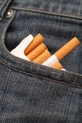 Pack of cigarettes in pocket of jeans