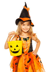 Little girl in Halloween witch dress