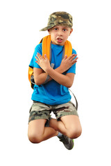 cool boy with backpack and a cap jumping