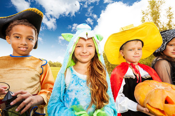 Kids wear Halloween costume outside in park