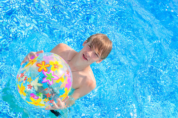 teenager with a beach ball in the water