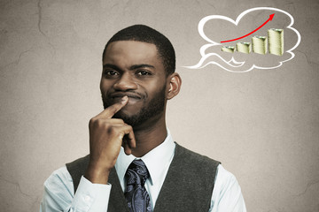 Thoughtful business man thinking how make money