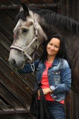 Beautiful young woman and gray horse portrait