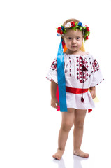 Little girl in the Ukrainian national clothes isolated on white