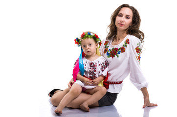 Woman with a little girl in the Ukrainian national clothes isola