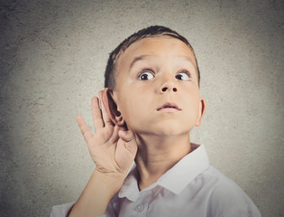 Curious man, boy, listens parents adult talk hand to ear gesture