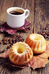 Two cupcake, coffee and autumn leaves