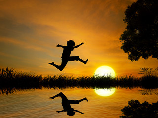 Happy boy, teenager jumping in water, over lake with
